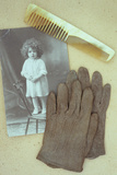 Pair of Pale Brown Cotton Victorian Childs Gloves Lying Photographic Print by Den Reader