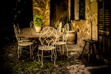 Decorative Table and Chairs on Patio in France Photographic Print by Will Wilkinson
