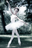 Female Youth with Wearing White Ballet Dress Standing on Point Outdoors Stampa fotografica di Tanneke Peetoom