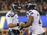 NFL Super Bowl 2014: Feb 2, 2014 - Broncos vs Seahawks - Russell Wilson, Marshawn Lynch Photographic Print by Matt Slocum