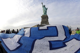 NFL Super Bowl 2014: Feb 2, 2014 - Broncos vs Seahawks - 12th Man Flag at Statue of Liberty Photographic Print