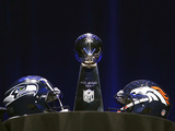 NFL Super Bowl 2014: Feb 2, 2014 - Broncos vs Seahawks - Super Bowl XLVIII Helmets, Lombardi Trophy Posters by Charlie Riedel