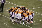 NFL Super Bowl 2014: Feb 2, 2014 - Broncos vs Seahawks - Broncos Huddle Photo by Charlie Riedel