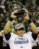 Russell Wilson with the NFC Championship Trophy 2013 NFC Championship Game Photo