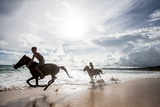 Two Young Boys and their Horses Play in the Ocean in Nihiwatu Photographic Print by James Morgan