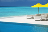 Infinity Pool and Lounge Chairs, Maldives, Indian Ocean, Asia Photographic Print by Sakis Papadopoulos