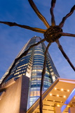 Low Angle View at Dusk of Mori Tower and Maman Spider Sculpture Photographic Print by Gavin Hellier