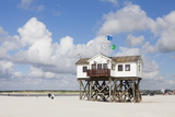 Stilt Houses on a Beach Photographic Print by Markus Lange