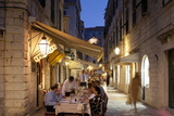 People Eating at Outdoor Restaurant at Dusk in the Old Town, Dubrovnik, Croatia, Europe Photographic Print by John Miller