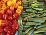 Red Peppers, Yellow Peppers and Courgettes on a Market Stall Photographic Print by John Miller
