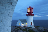 The Idyllic Lindesnes Fyr Lighthouse Illuminated at Dusk Photographic Print by Doug Pearson