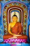 Colourful Buddha Statue at Isurumuniya Vihara Fotografisk trykk av Matthew Williams-Ellis
