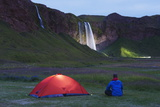 Seljalandsfoss Waterfall Lit Up at Night, Southern Region, Iceland, Polar Regions Photographie par Christian Kober