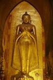 Statue of the Buddha, Patho Ananda Temple, Bagan (Pagan), Myanmar (Burma), Asia Reproduction photographique par  Tuul