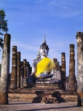 Statue of the Buddha with Religious Offerings, Wat Mahathat, Sukothai, Thailand Photographic Print by Adina Tovy