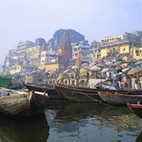 Boats Moored in Front of Ghats on the River Ganges, Varanasi, Uttar Pradesh, India Photographic Print by Tony Gervis
