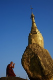 Buddhist Monk Praying at the Golden Rock of Nwa La Bo Photographic Print by  Tuul