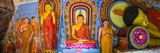 Colourful Buddha Statues at Isurumuniya Vihara Photographic Print by Matthew Williams-Ellis