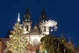 Christmas Tree and Decorations in Front of Tyn Gothic Church Photographic Print by Richard Nebesky