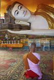 Nun in Front of Reclining Buddha Statue, Shwethalyaung, Bago (Pegu), Myanmar (Burma), Asia Photographic Print by  Tuul