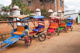 Colourful Rickshaws Line the Alleyways of Antsirabe, Madagascar, Africa Photographic Print by Lynn Gail