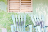Detail of Wall and Rocking Chair with Faded Paintwork in Green and Blue Photographic Print by Lee Frost