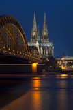 Cologne Cathedral, UNESCO World Heritage Site, and Hohenzollern Bridge at Dusk Photographic Print by Charles Bowman
