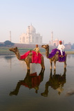 Man and Boy Riding Camels in the Yamuna River in Front of the Taj Mahal Photographic Print by Gavin Hellier