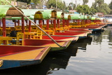 Line of Colourful Boats at the Floating Gardens in Xochimilco Photographic Print by John Woodworth