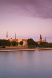 Riga Castle and the River Daugava Illuminated at Sunset, Riga, Latvia, Europe Photographic Print by Doug Pearson