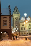 Snow-Covered Christmas Decorated Lamps and Gothic Town Hall Photographic Print by Richard Nebesky