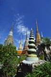Stupas at the Temple of the Reclining Buddha, Bangkok, Thailand Photographic Print by Robert Francis