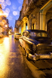 Low Light View Along a Street Towards the Capitolio with Street Lights Reflecting in the Wet Tarmac Photographic Print by Lee Frost