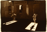Children dancing in shafts of light Photographic Print by Theo Westenberger