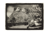 Couple viewing Mt Rushmore, South Dakota, USA Photographic Print by Theo Westenberger
