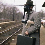 1960s-1970s Man Commuter Waiting for Train Wearing Gas Mask Pollution Photographic Print