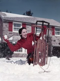 1950s Woman Hiding Behind Sled Throwing Snowball Front Stone House Photographic Print