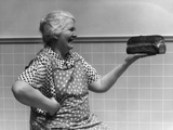 1930s-1940s Grandmother in Apron Admiring Loaf of Freshly Baked Bread Photographic Print