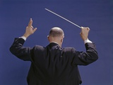 1950s-1970s View of Back of Bald Man Conducting a Symphony Orchestra Photographic Print
