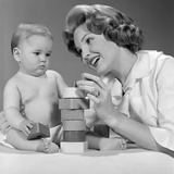 1960s Mother and Unhappy Baby Playing with Blocks Photographic Print