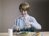 1960s Teenage Girl Eating Wholesome Dinner Photographic Print