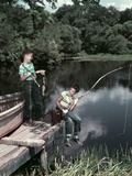 1950s Two Boys Fishing in Lake from Dock Outdoor Photographic Print