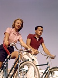 1950s-1960s Couple Man Woman Riding Bicycles Outdoors Photographic Print