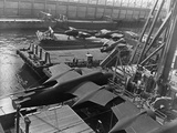 Heavy Bombers on Barges Awaiting Loading onto Cargo Vessel in New York Harbor for Shipment Photographic Print by Edward L.
