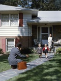 1950s Wife Watching Man Coming Home Arms Extended to Son and Daughter Photographic Print