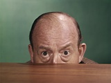 1960s Balding Man Peeking over Desktop with Only Top Half of Head Showing Photographic Print