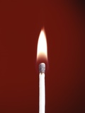 1970s Burning Wooden Safety Match on Red Background Flame Photographic Print