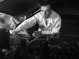 1950s Man Automotive Mechanic Servicing Car Engine Photographic Print