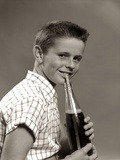 1950s Boy Drinking Carbonated Beverage from Soda Pop Bottle with Straw Photographic Print
