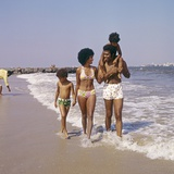 1970s African-American Family of Four Walking on Beach Photographic Print